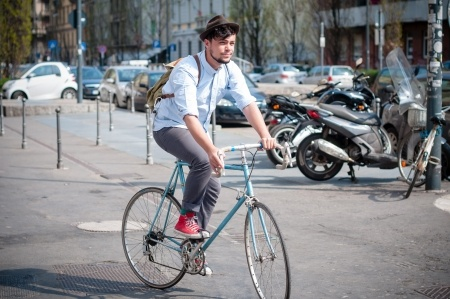 Hipster on a bike - he liked Dynamics CRM Spring 2015 before it was cool